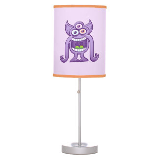Three-eyed alien monster laughing mischievously table lamp