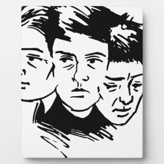 three faces plaque