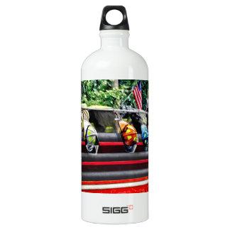 Three Fire Helmets On Fire Truck Water Bottle