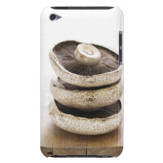 Three flat mushrooms in pile on wooden board, iPod touch Case-Mate case