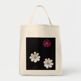 Three Flowers On A Black Background Tote Bag