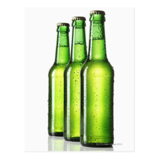 Three green bottles of beer on white background, postcard