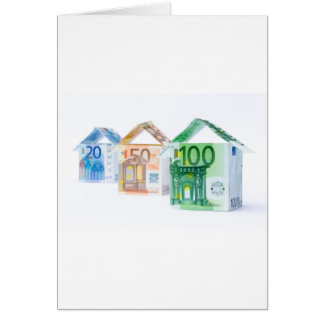 Three houses made of bank notes