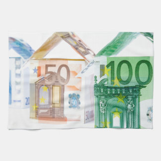 Three houses made of bank notes kitchen towel