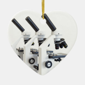 Three microscopes in a row isolated on background ceramic ornament