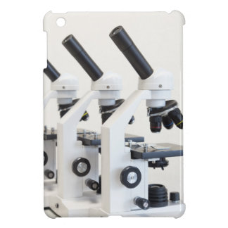 Three microscopes in a row isolated on background cover for the iPad mini