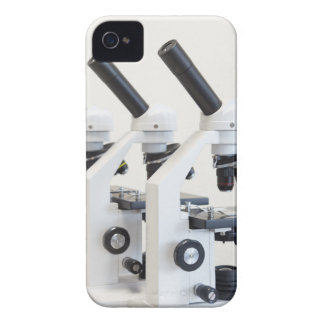 Three microscopes in a row isolated on background iPhone 4 case