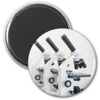 Three microscopes in a row isolated on background magnet