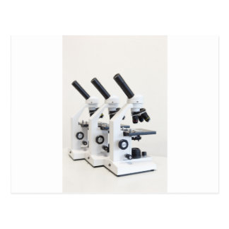 Three microscopes in a row isolated on background postcard