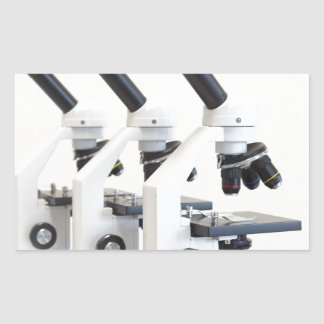 Three microscopes in a row isolated on background sticker