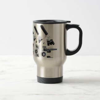 Three microscopes in a row isolated on background travel mug