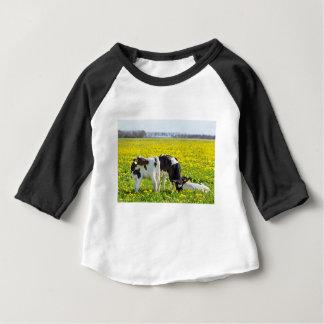 Three newborn calfs in spring dandelions meadow baby T-Shirt