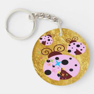 Three pink and black ladybug with stars keychain