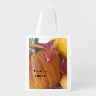 Three pumpkins with leaves trick or treat reusable grocery bag