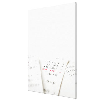 Three receipts on white background. There are Canvas Prints