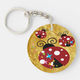 Three red and black ladybug with stars keychain