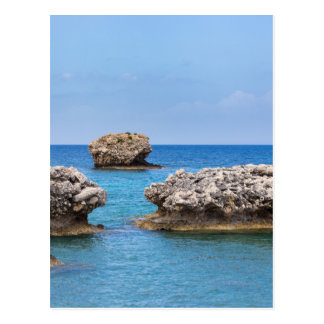 Three separate rocks offshore in sea postcard