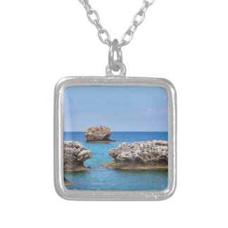 Three separate rocks offshore in sea silver plated necklace