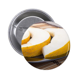 Three slices of juicy yellow melon 2 inch round button
