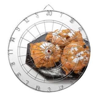 Three sugared fried fritters or oliebollen dartboard