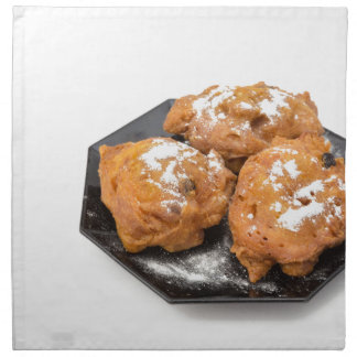 Three sugared fried fritters or oliebollen napkin