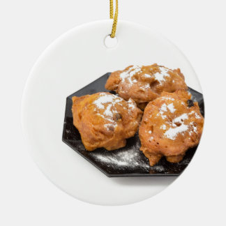 Three sugared fried fritters or oliebollen round ceramic ornament