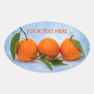 Three Tangerines Oval Sticker