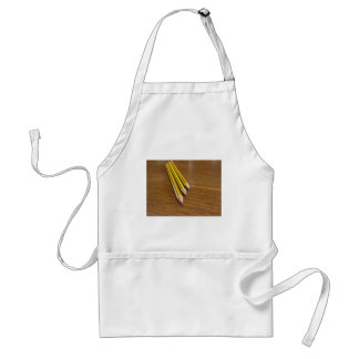 Three used pencils on wooden table standard apron