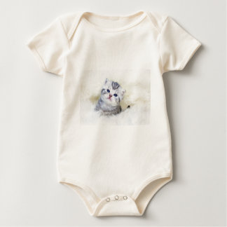 Three weeks old young cat sitting on sheep fur baby bodysuit