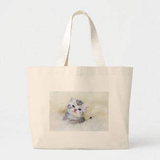 Three weeks old young cat sitting on sheep fur large tote bag