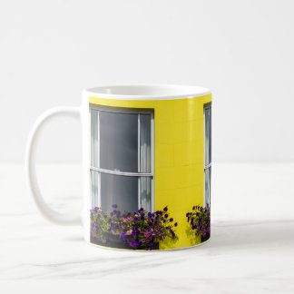 Three windows on a yellow wall coffee mug