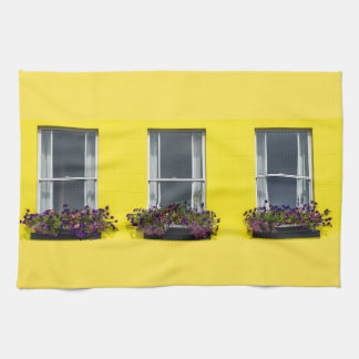 Three windows on a yellow wall kitchen towel