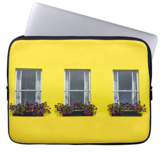 Three windows on a yellow wall laptop sleeve
