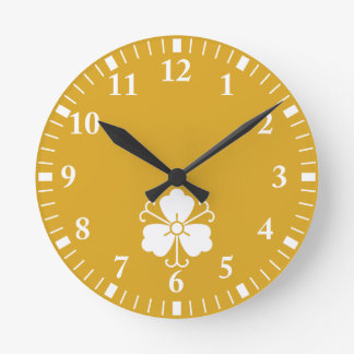 Three wisteria blooms with vines round clock