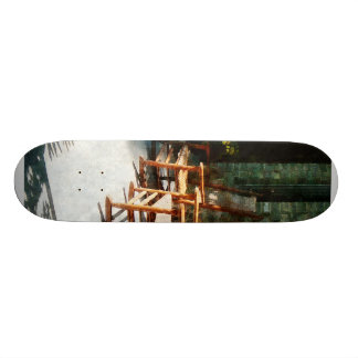 Three Wooden Rocking Chairs on Sunny Porch Skate Deck