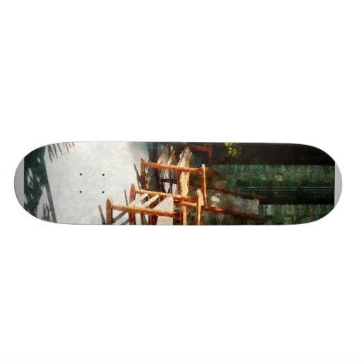 Three Wooden Rocking Chairs on Sunny Porch Skate Decks