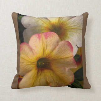 Throw pillow adorned with beautiful floral photo.