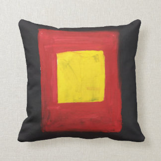 Throw Pillow that is Yellow, Red. and Black.