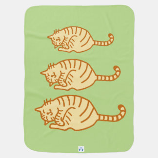 Tiger cat family receiving blankets