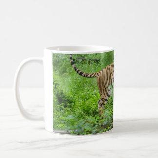 Tiger on log coffee mug