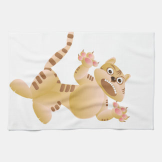 Tiger, the cat growls and threatens paws claws kitchen towel