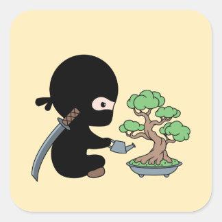 Tiny Ninja Watering Bonsai Tree on Yellow Square Sticker