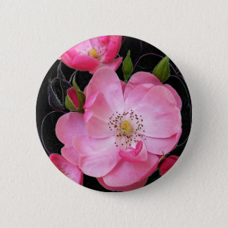 tiny rosebud opens 2 inch round button