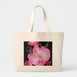 tiny rosebud opens large tote bag