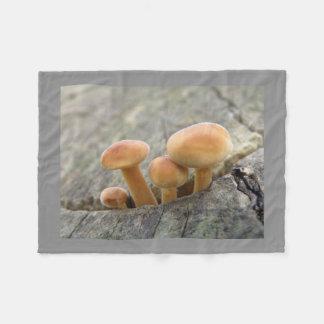 Toadstools on a Tree Trunk Fleece Blanket