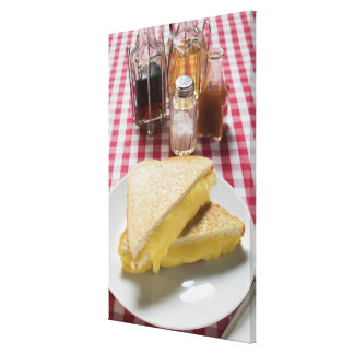 Toasted cheese sandwiches on plate, vinegar, stretched canvas print