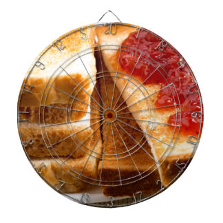 Toasted slices of bread with strawberry jam dartboard