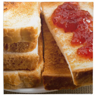 Toasted slices of bread with strawberry jam napkin