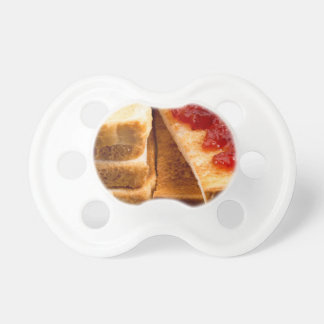 Toasted slices of bread with strawberry jam pacifier