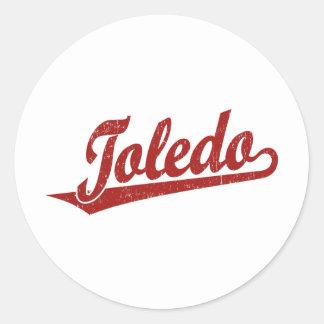 Toledo script logo in red distressed classic round sticker